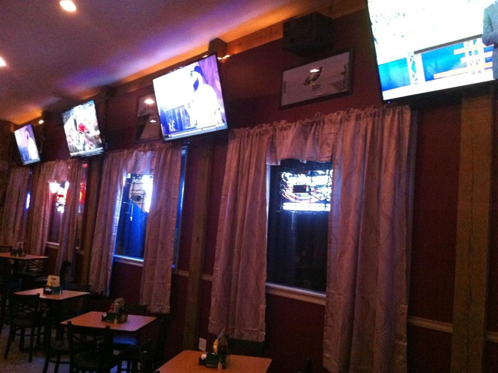 Interior shot the Pub. TV screens over the windows