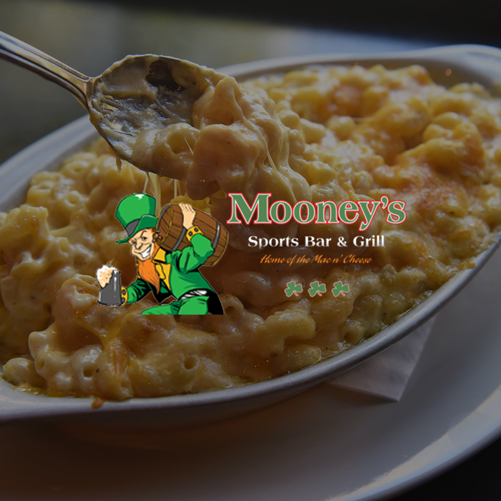 Bowl of mac and cheese with Mooney's Sports Bar & Grill logo in center