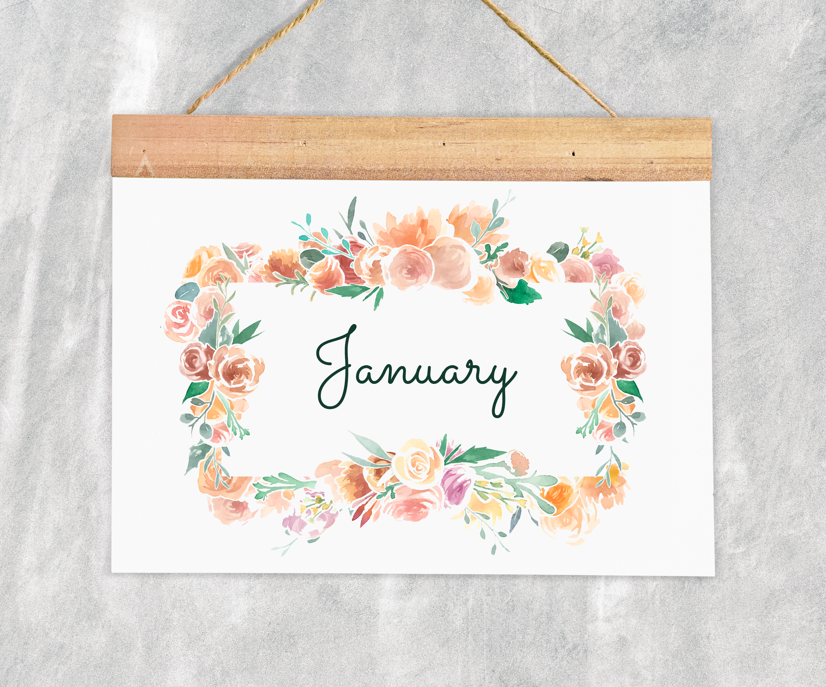 'January' written on hanging white board with floral border