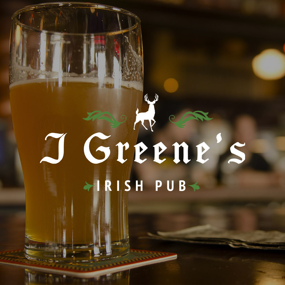 Beer on bar with J Greens Irish Pub logo in center