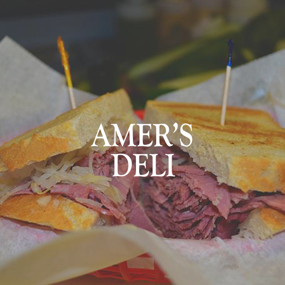 Sandwich with Amer's Deli logo in center