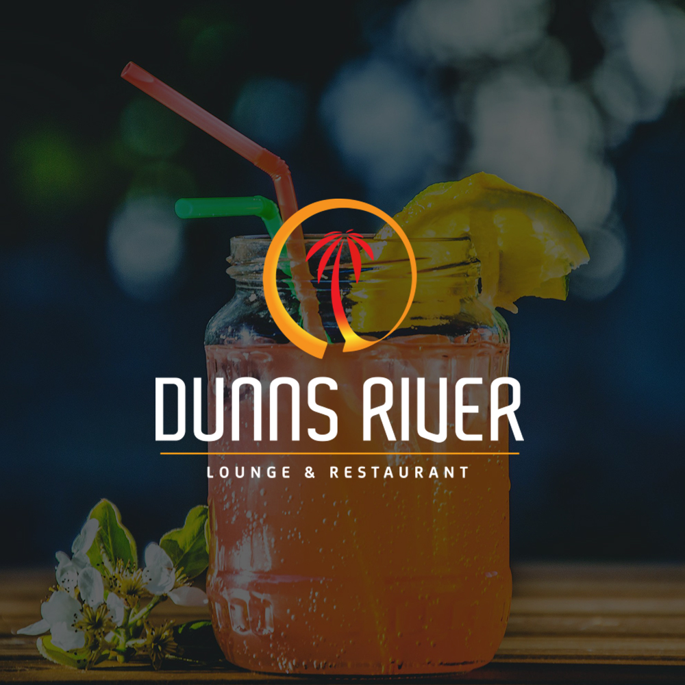 Drink on a bar with Dunns River Lounge & Restaruant logo in center