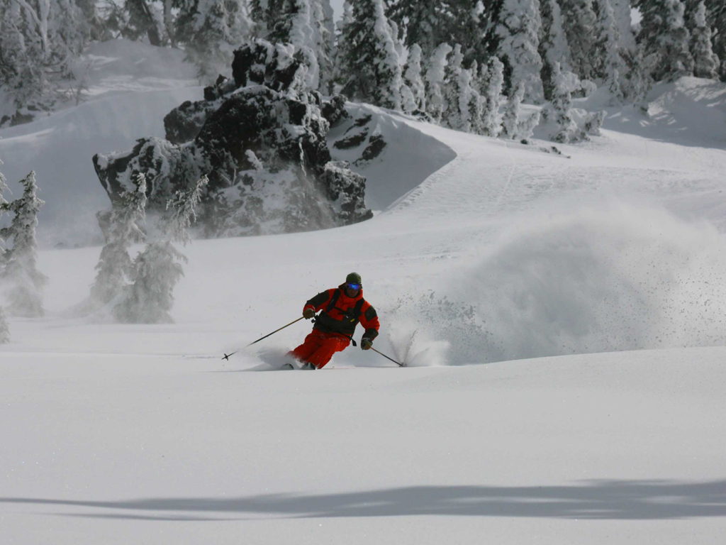 skier going down mountain side