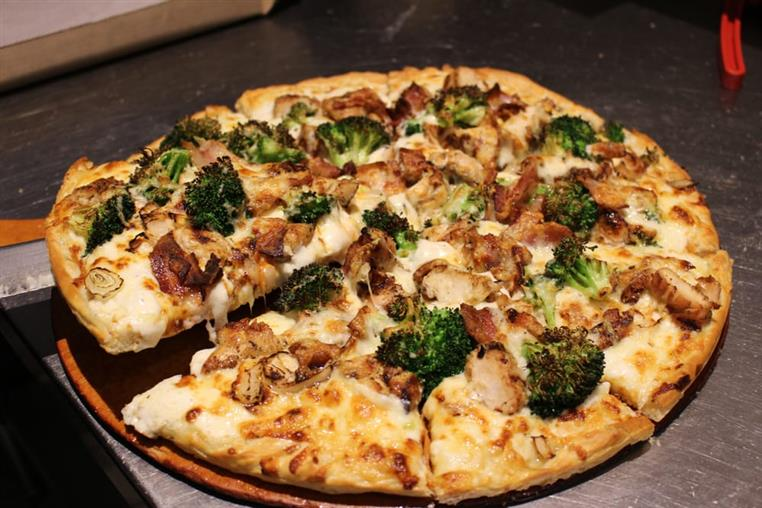 Chicken and broccoli alfredo pizza.
