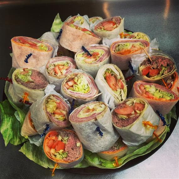 assortment of wraps cut in half on a tray