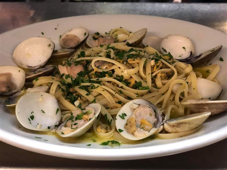 Steamed clams served with linguine