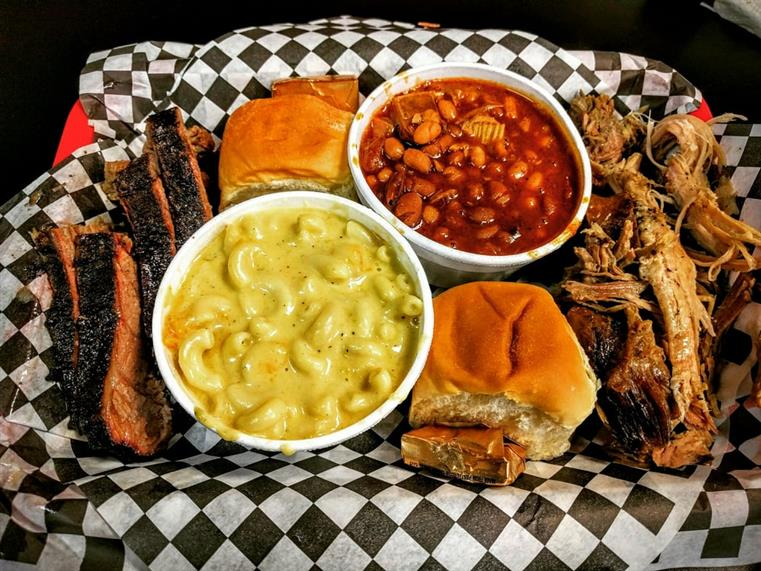Smoked Ribs, Baked Beans, Rolls, and Mac N Cheese, on a tray