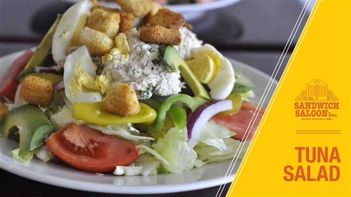 Tuna Salad. Two scoops of tuna with avocado, bell peppers, pepperocinis, tomatoes, pickles, topped with hardboiled egg and croutons, choice of dressing