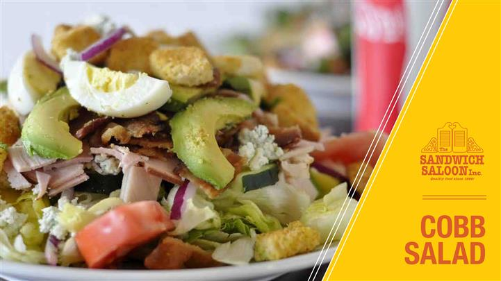 Cobb Salad. Generous portions of turkey, ham, bacon, fresh bleu cheese, avocado, tomatoes, pepperoncini, bell peppers, hardboiled eggs, onion and