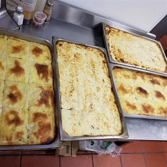 several trays of food