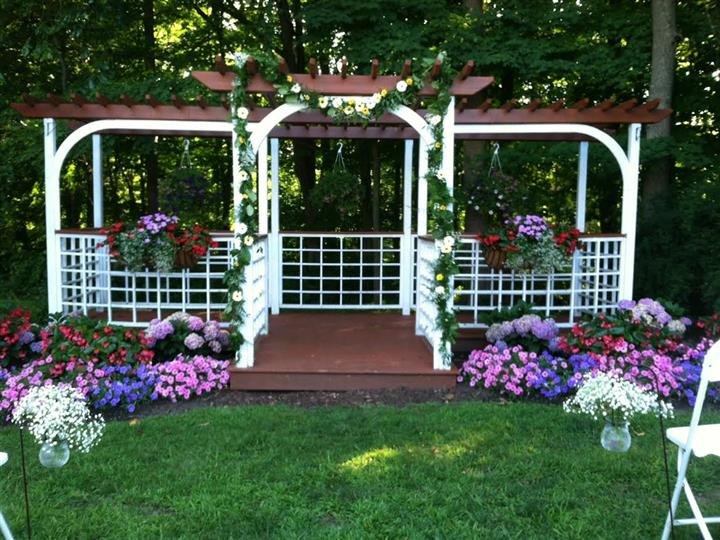 Gazebo with colorful flowers in the front
