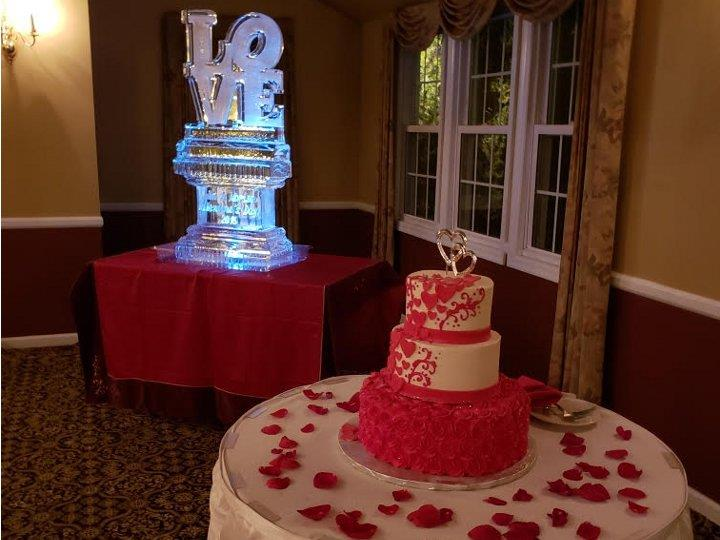 Valentine's Day Wedding with a LOVE ice sculpture and a wedding cake