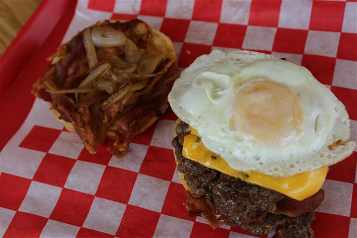 double bacon cheeseburger with a fried egg