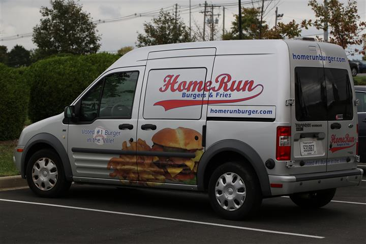 delivery van with Hone Run logo graphic