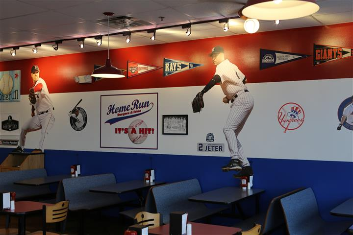 wall with baseball pennants and pictures