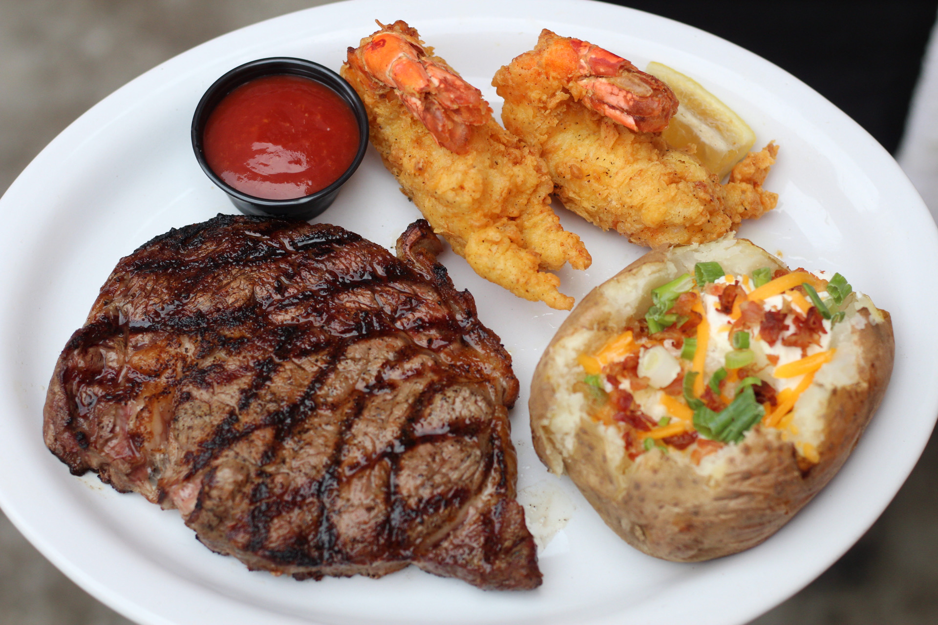 Ribeye, Jumbo Prawns, and a Loaded Baked Potato