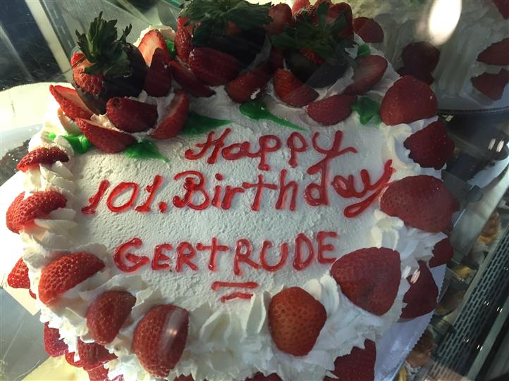 Happy 101st Birthday Gertrude cake with strawberries on top