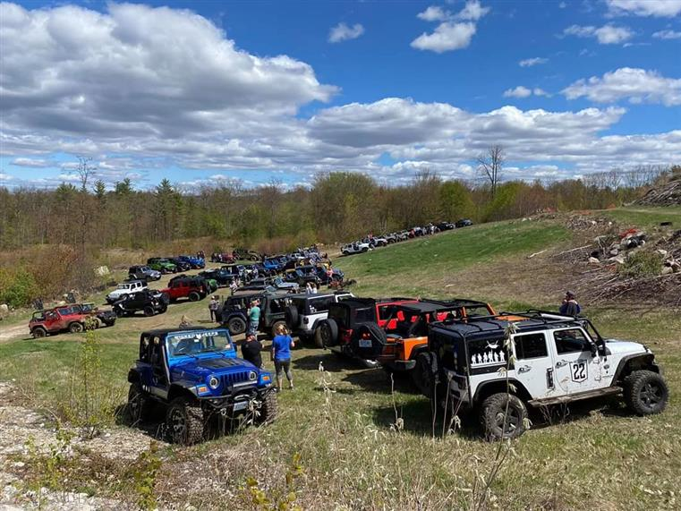 several jeep trucks parked in a field