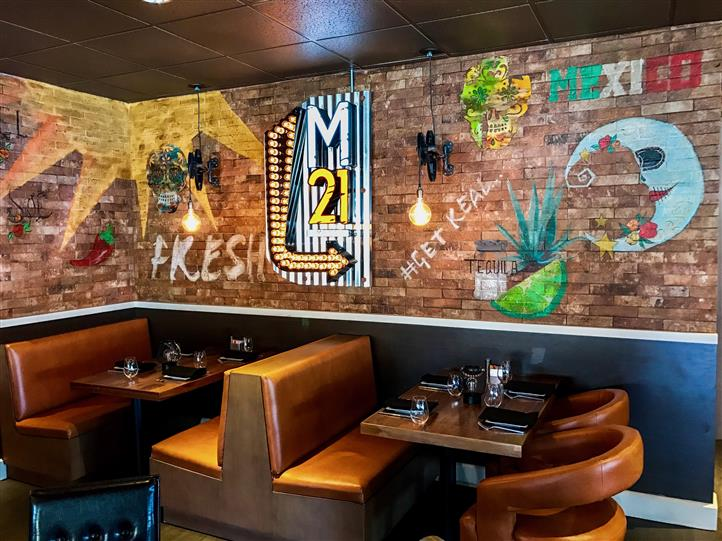 Interior shot of the restaurant with graffiti on the wall