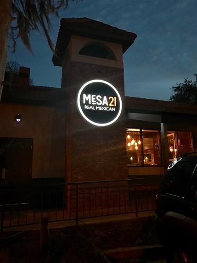 Outside shot of the restaurant's neon sign at night