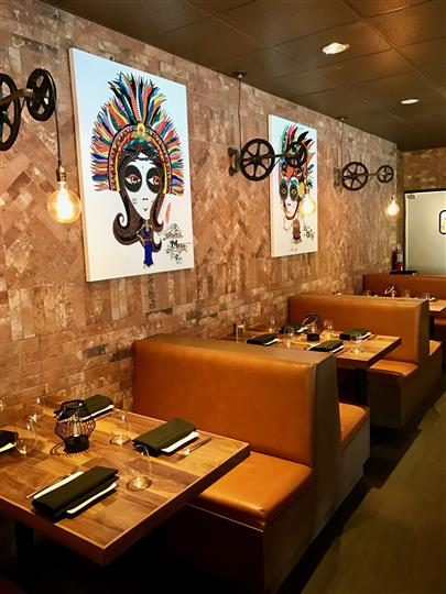 Interior shot of the restaurant with paintings on the wall