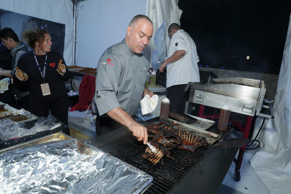 Chef Ian Russo preparing a meal at nyc wine and food festival