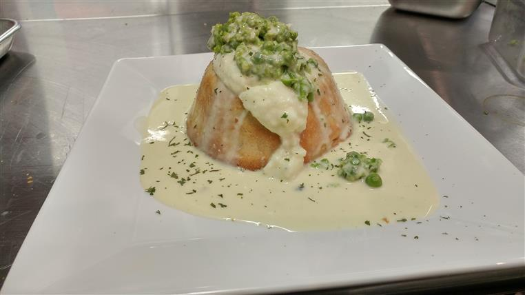 Pot pie floater topped with mashed potato, green pea mash