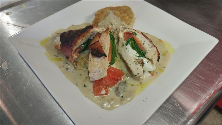 Chicken dish with tomatoes, spinach, mozzarella