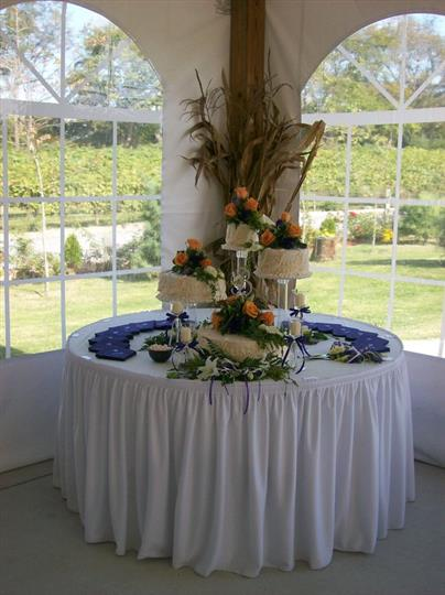 A wedding cake on a round table with flowers for decoration