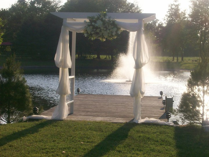 White wedding decoration in frond of the lake with the fountain