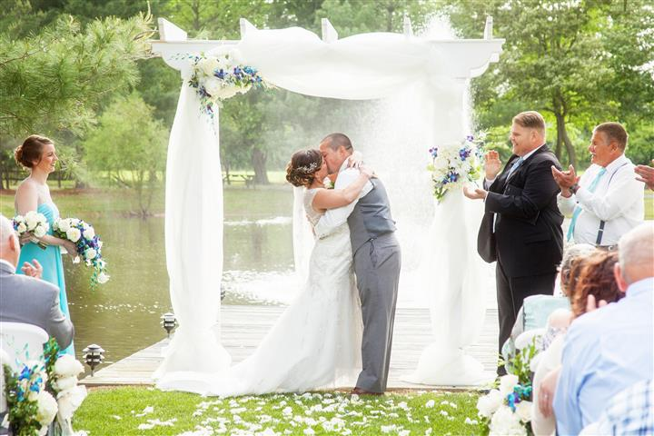 A wedding photo of a kissing couple