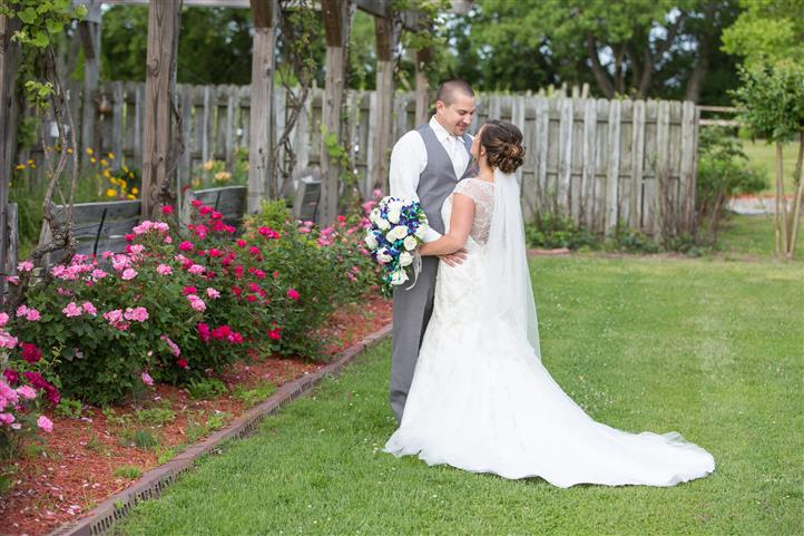 A wedding photo of a couple in the garden