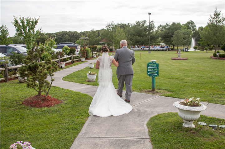 The wedding couple walking in the yard