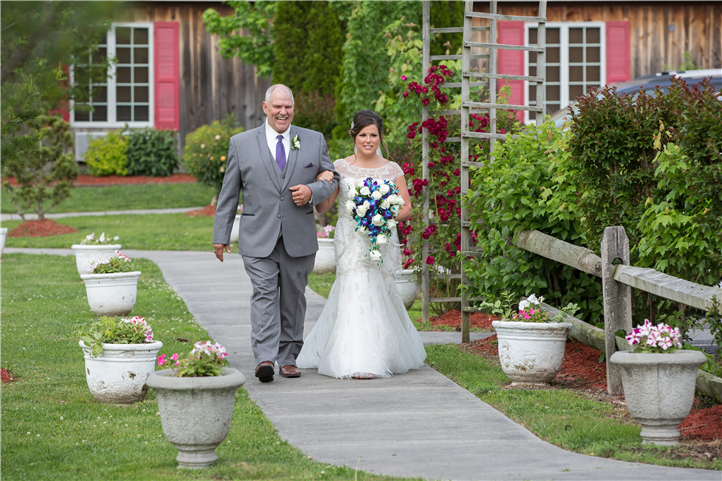 A wedding couple walking outside the building