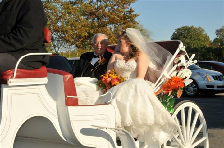 The bride with her father on a white horse-drawn cab