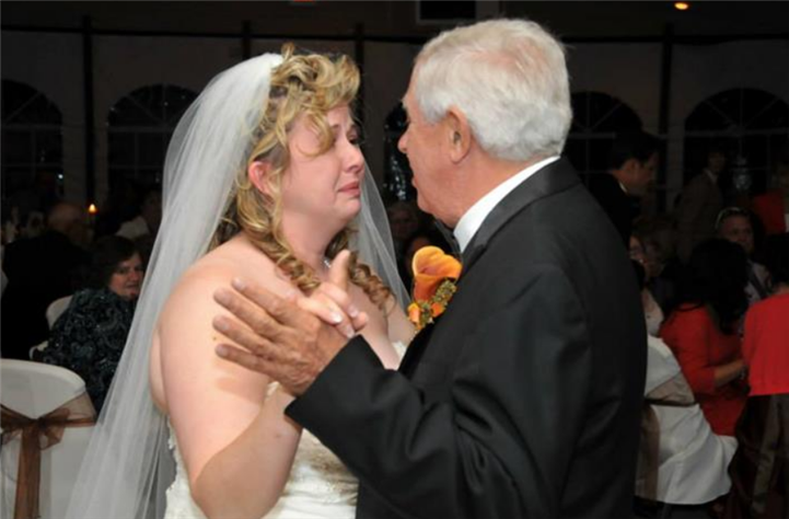 The bride dancing with her father