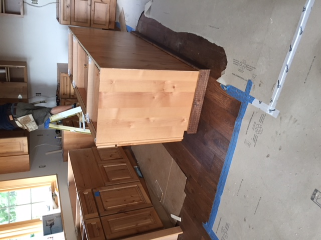 cabinets being installed in a kitchen