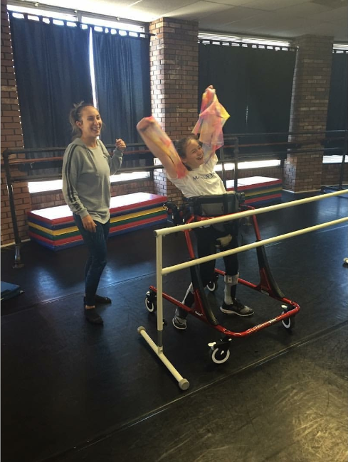 young girl using adaptive device to allow her to dance