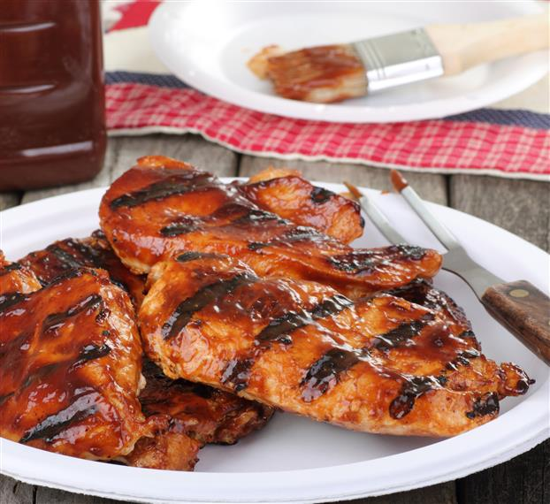 5 Pieces of grilled chicken covered in barbecue sauce