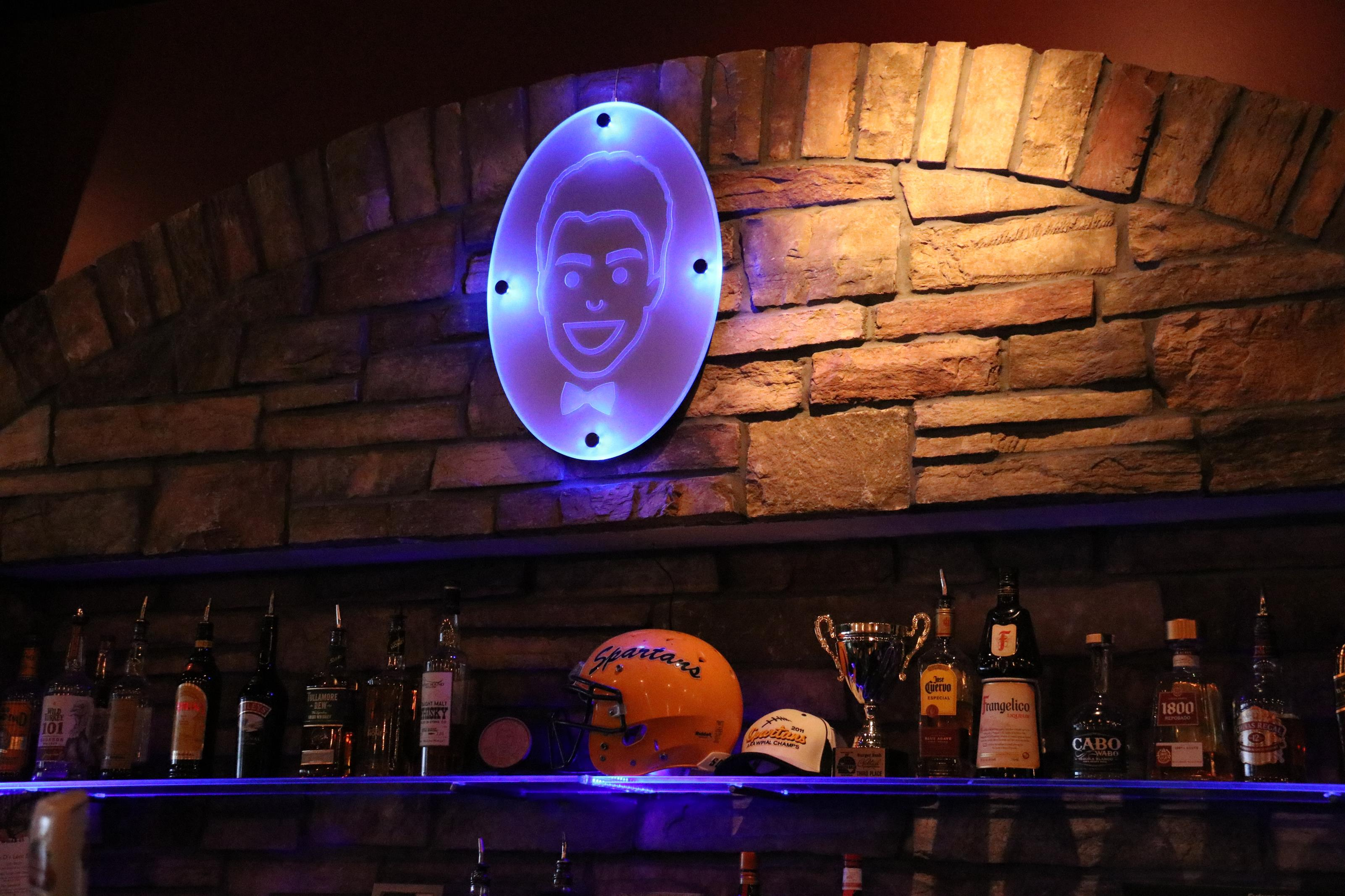 bar area with logo of bobby d's