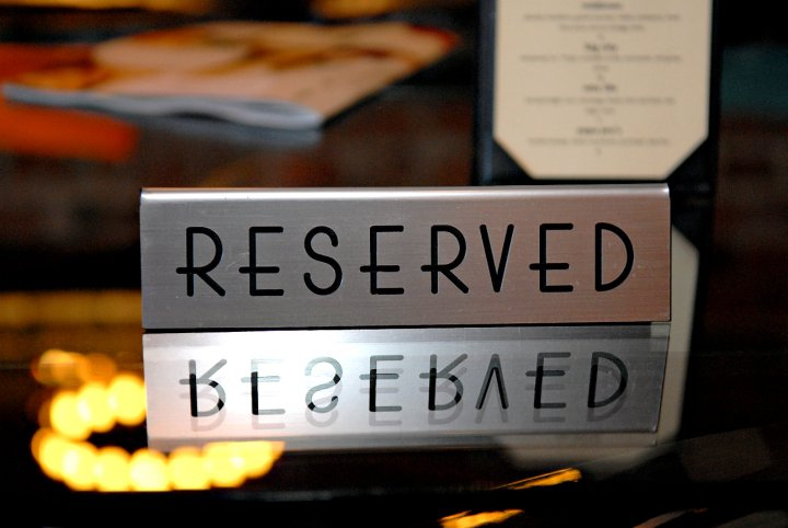 Reserved sign on dining table