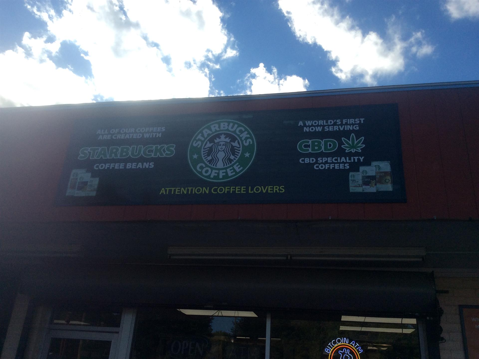 starbucks banner hung outside of store, all our coffee is created with starbucks coffee beans, now serving CBD