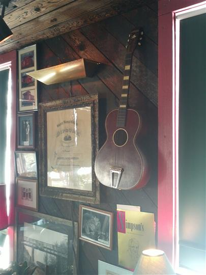 Mounted Guitar and framed programs