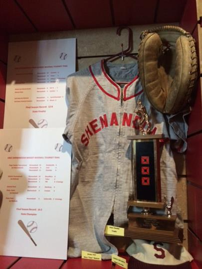 Old Jersey with sport trophy, catcher's mitt,