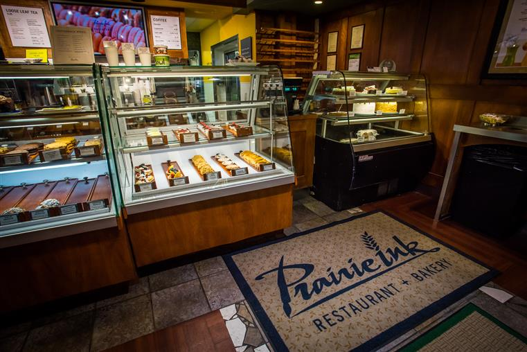 Interior shot of the pastry store with the fridges of several pastries