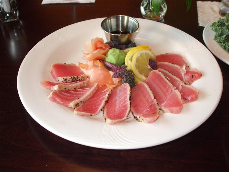 Seared ahi tuna with wasabi and ginger on white plate