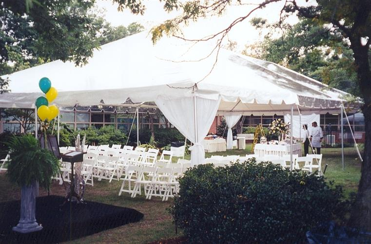 party tent outside set up with folding chairs