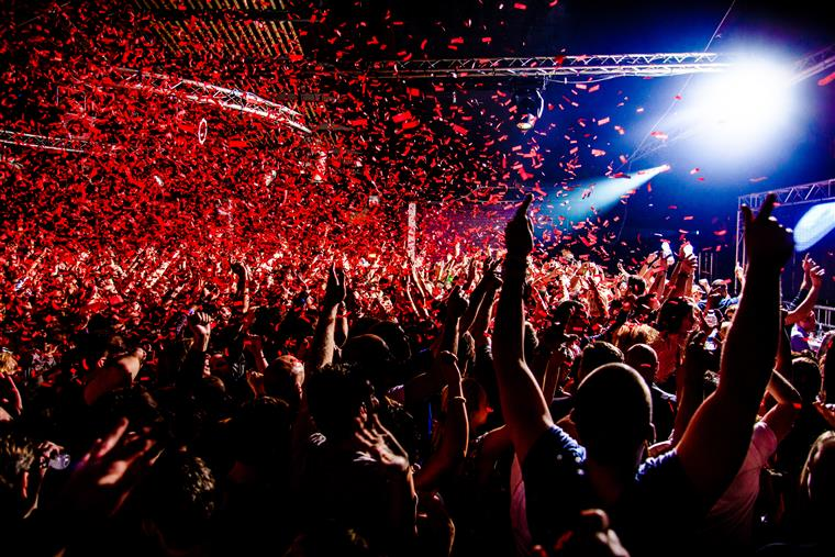 crowd with red confetti in the air