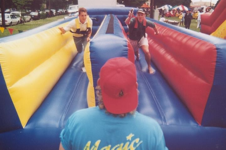 two kids going against each other on an inflatable obstacle course