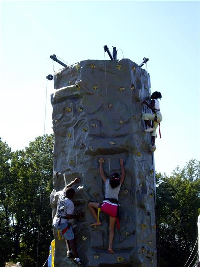 kids climbing up the rock climbing wall
